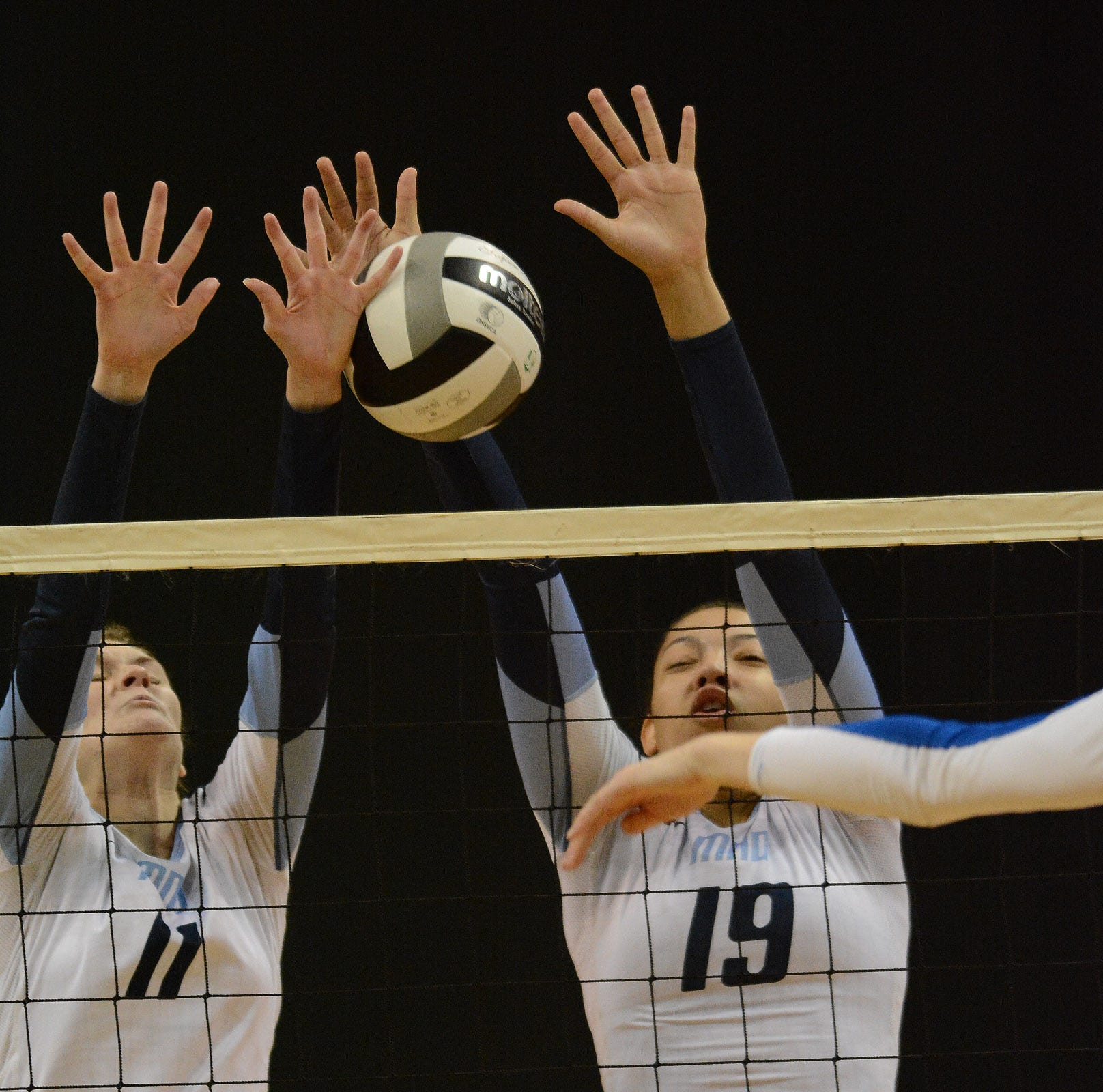 LSU recruit and junior outside hitter Sydney Mukes, right, returns for a Mount Notre Dame squad looking to repeat as Division I state champion.