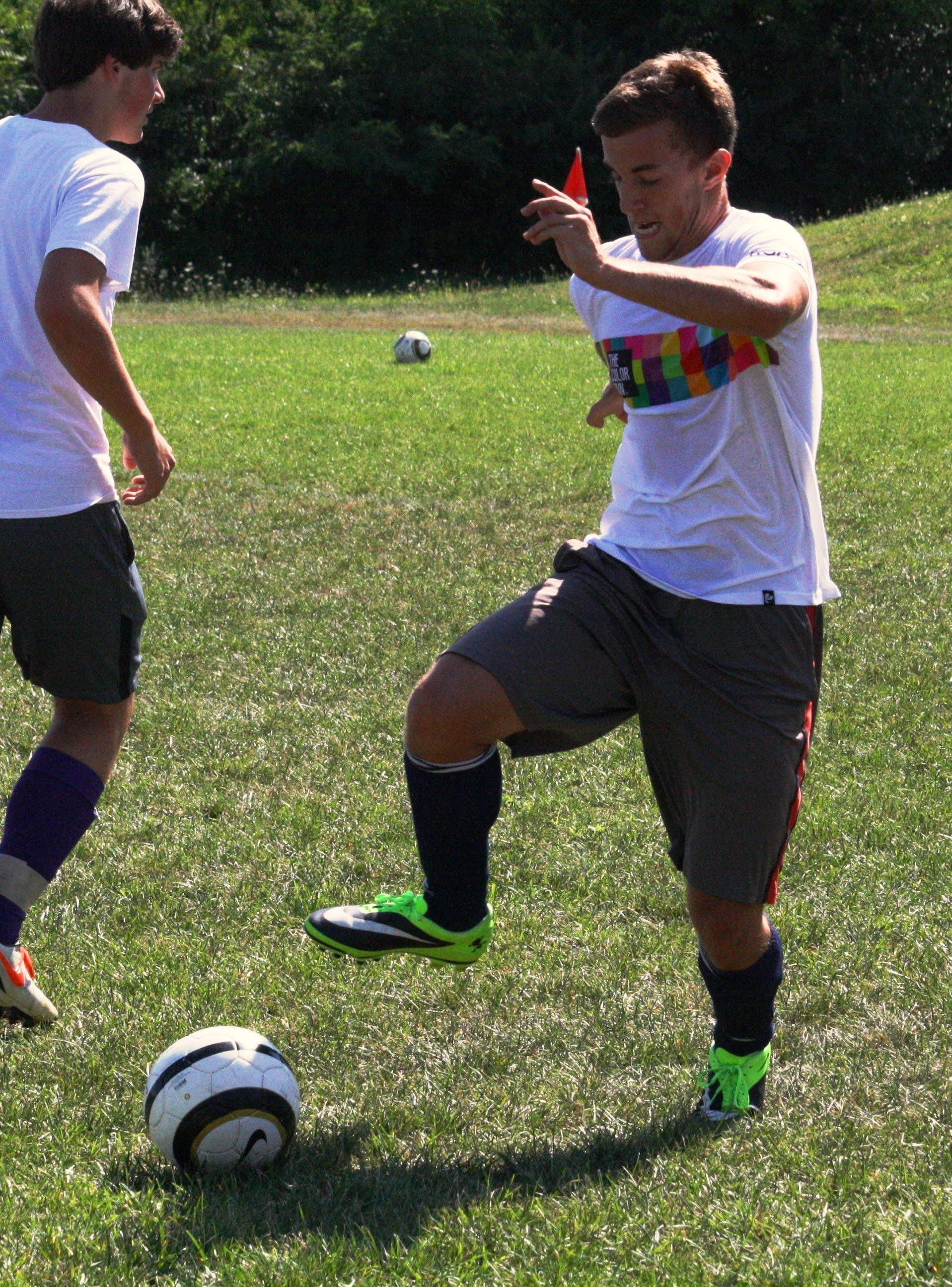Elder High School senior Nick Pangallo knocks the ball down during a practice drill Aug. 13 at the Panther Athletic Complex. Pangallo is a co-captain this season along with junior Joey Sabato.