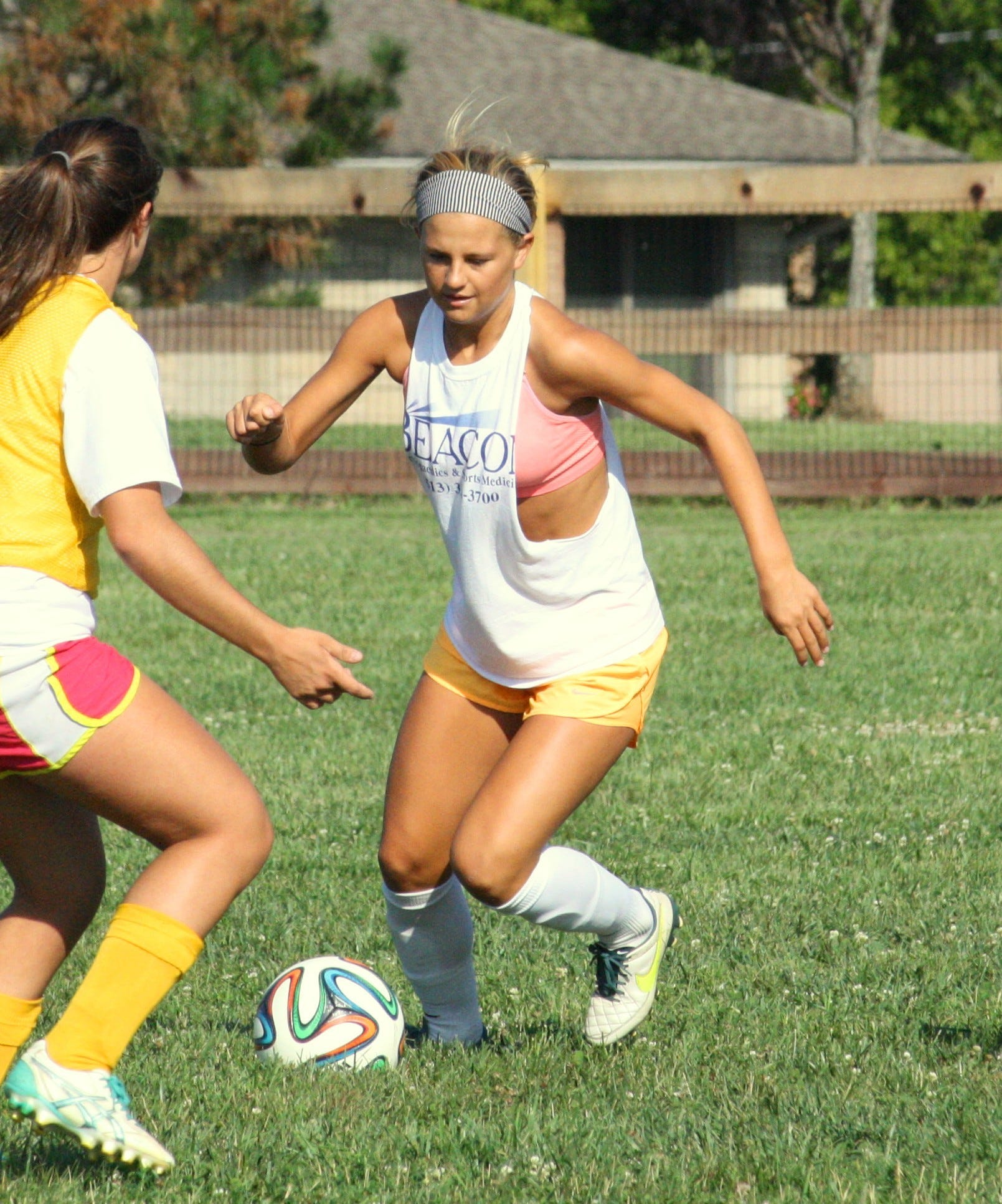 Oak Hills High School senior Bayley Feist dribbles through her defenders during a preseason practice at Rapid Run Middle School Aug. 13. Feist scored three goals and dished out four assists in just eight games last season before going down with an injury.