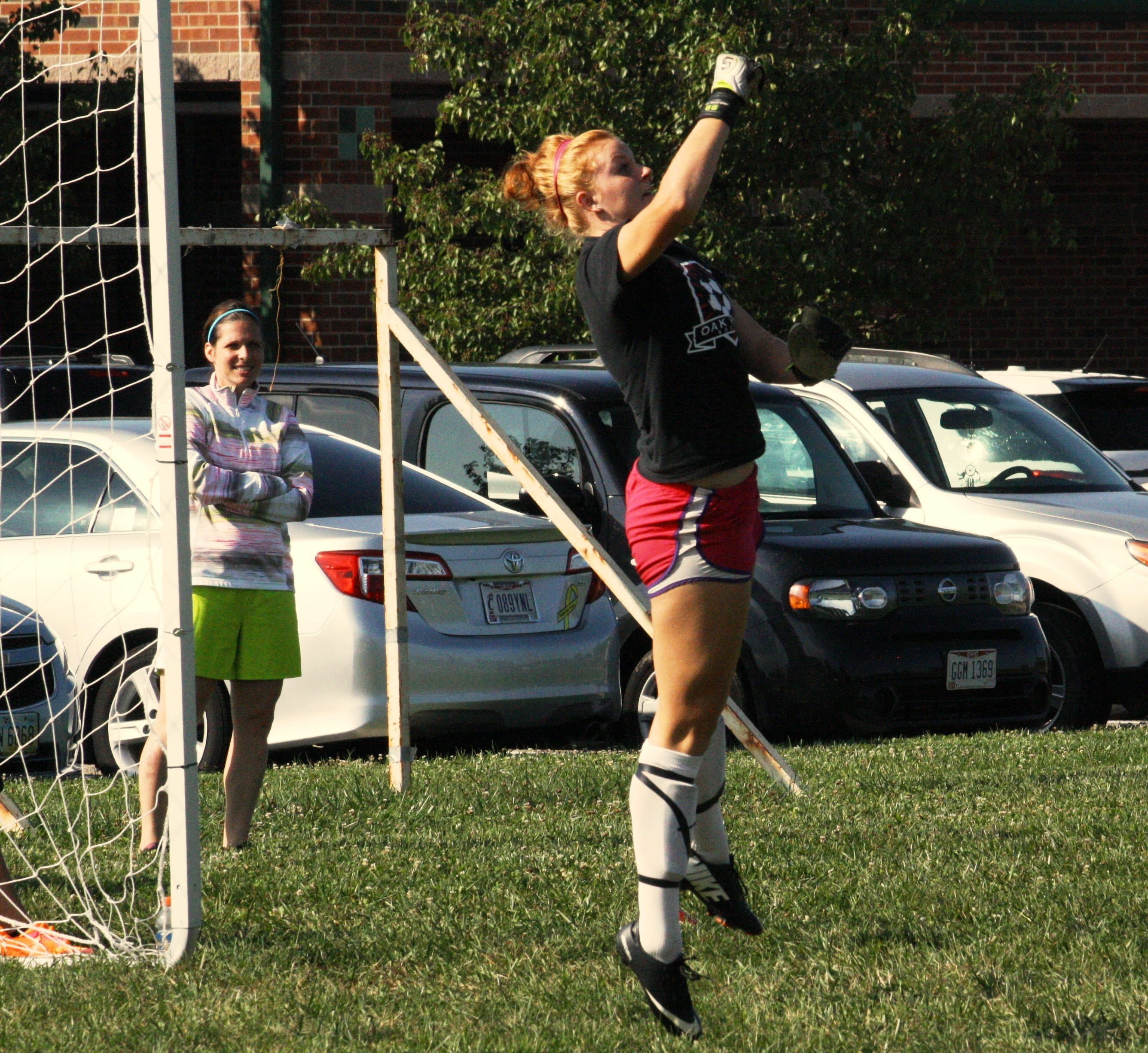 Oak Hills High School senior goalkeeper Emily Lohman jumps to make a save during a preseason practice drill Aug. 13 at Rapid Run Middle School. Lohman recorded nine shutouts in 2013.