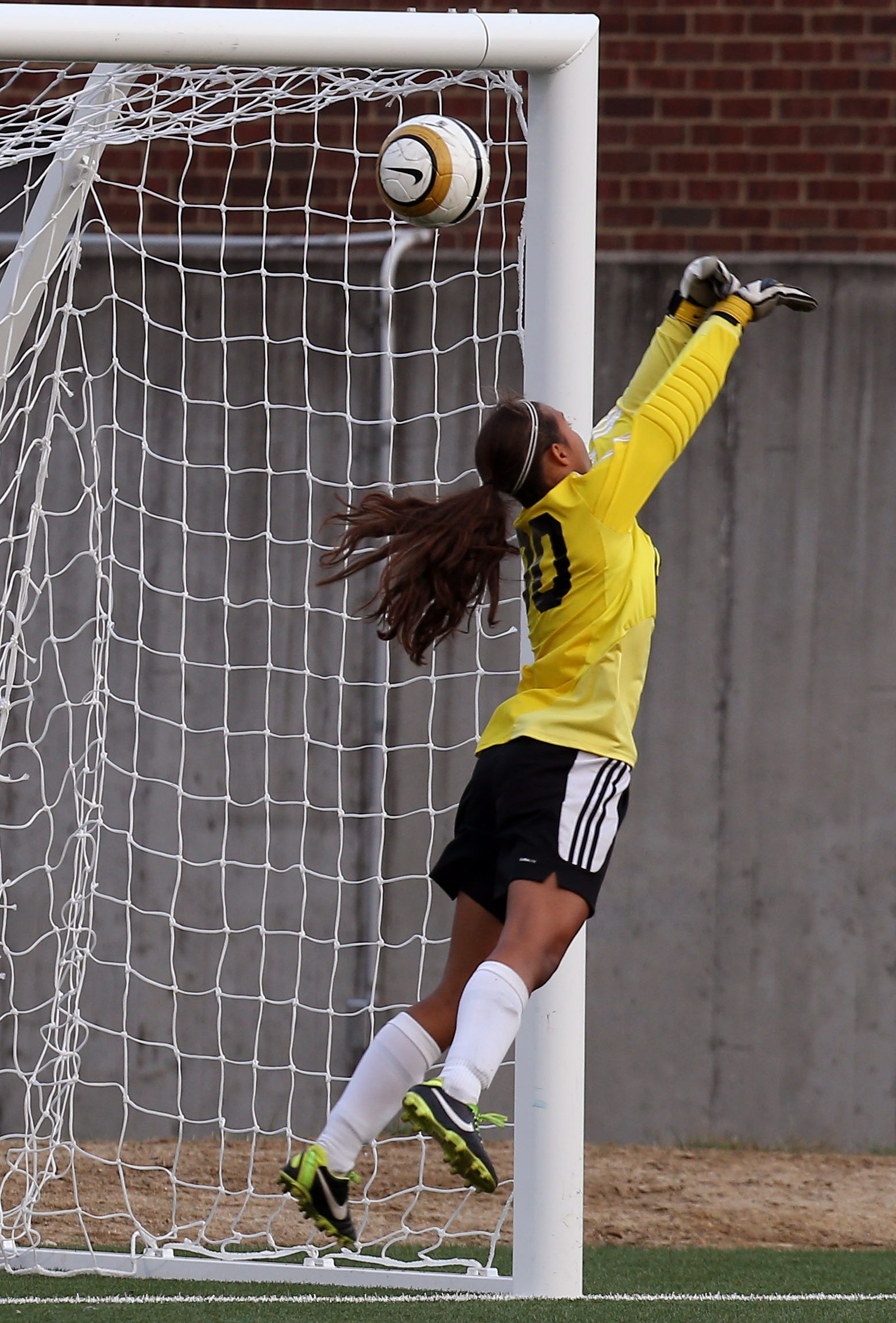 Indian Hill goalkeeper Ellie Schaub (00) tries to block a scoring goal from Wyoming's Emma Klug last September.