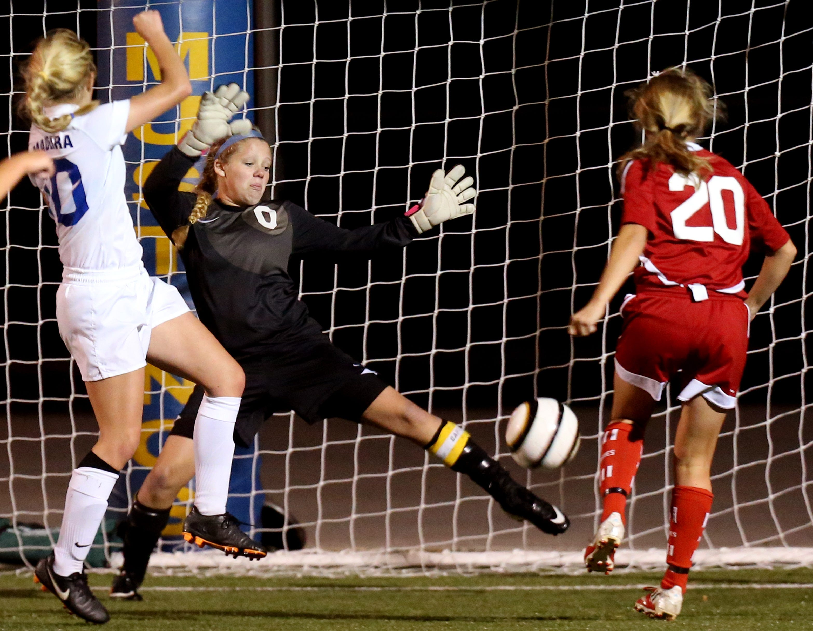 Indian Hill's Sophie Bell (20) scored the game-winning goal against Madeira goalkeeper Sarah Mahler (0) in the second half of their game with the Amazons last October.