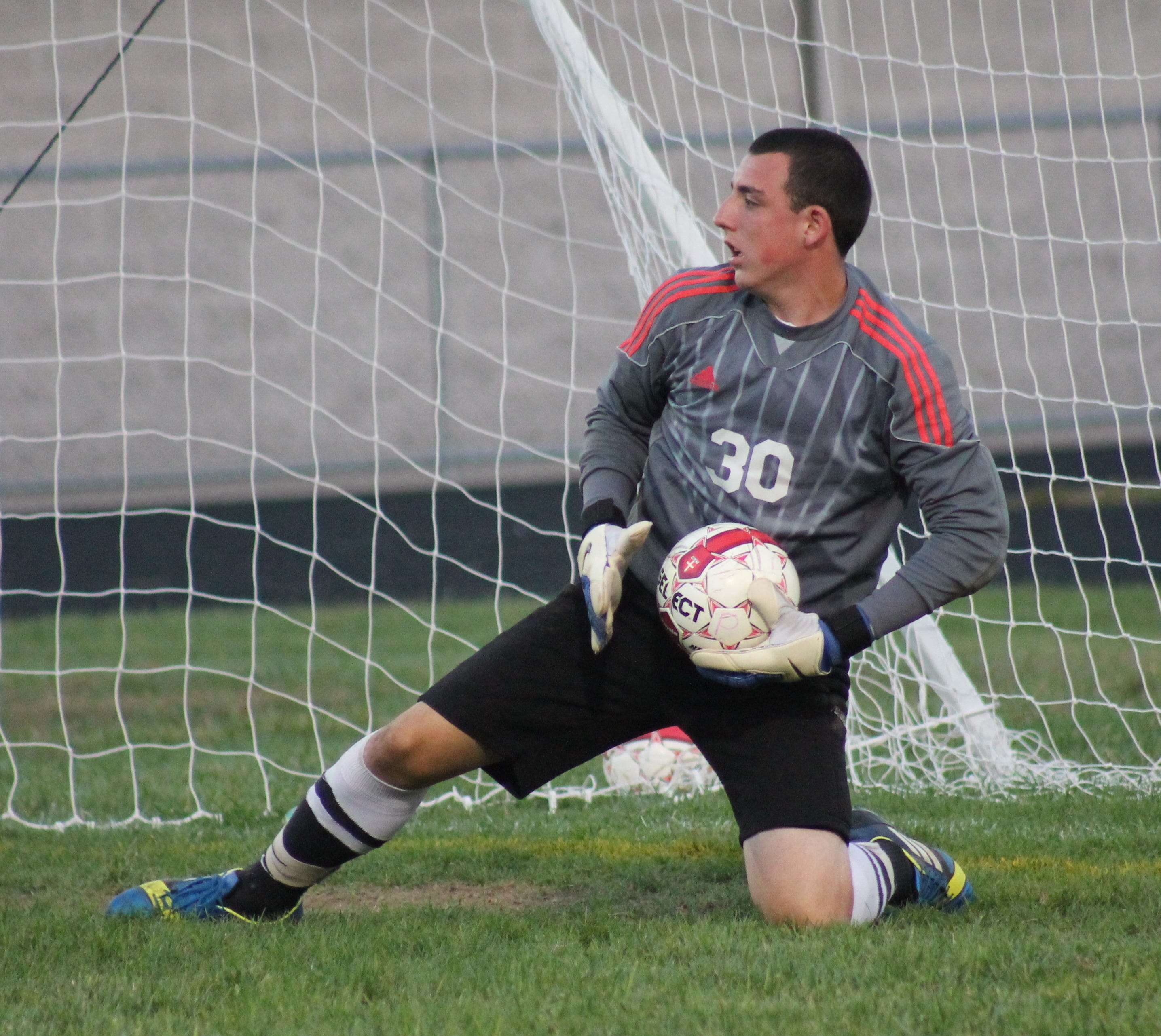 Deer Park goalkeeper Corey Huneke makes a save for the Wildcats.