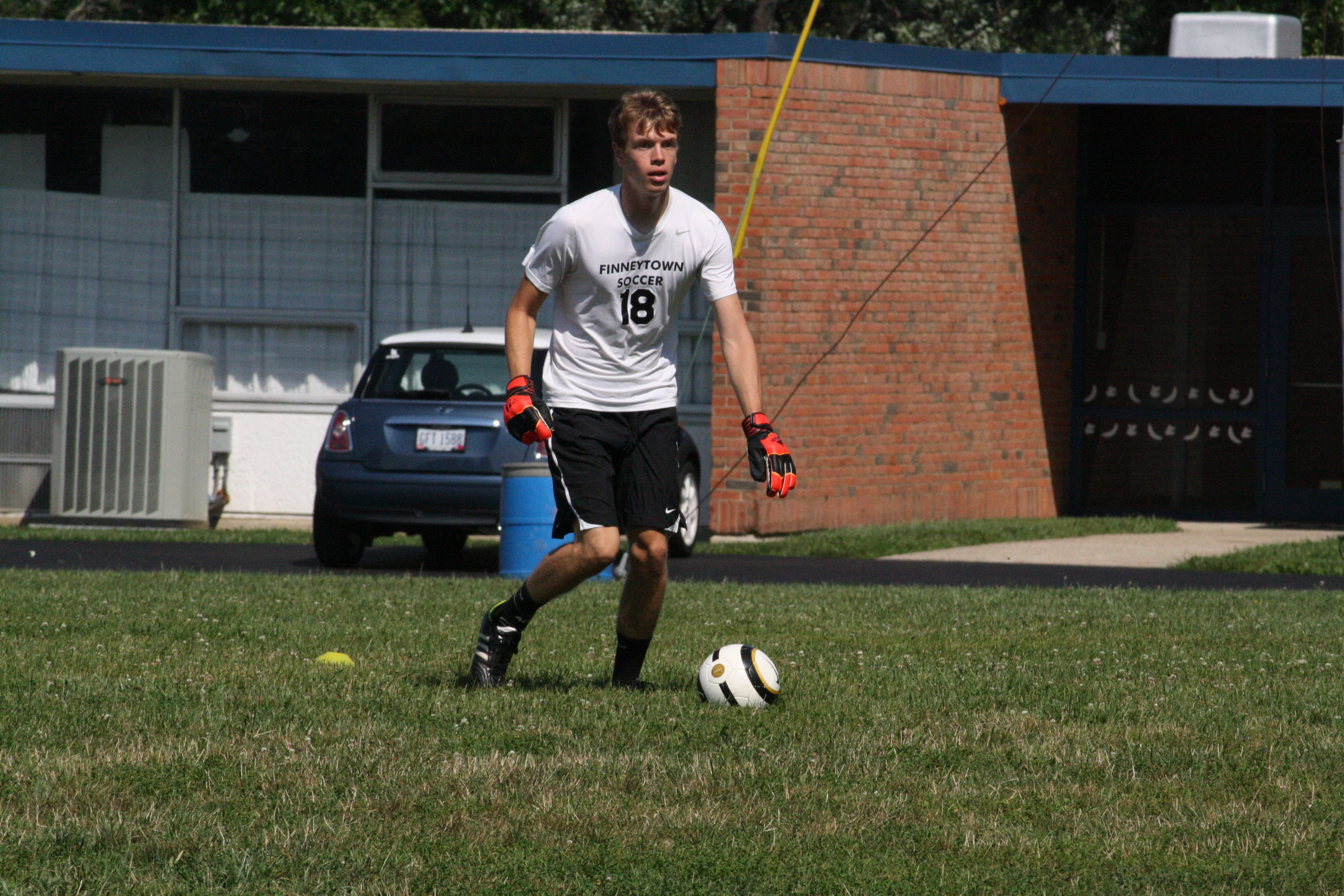 Finneytown High School senior goalkeeper Luke Steimle handles the ball with his feet during a practice drill Aug. 14. Steimle turned in an .850 save percentage last season.