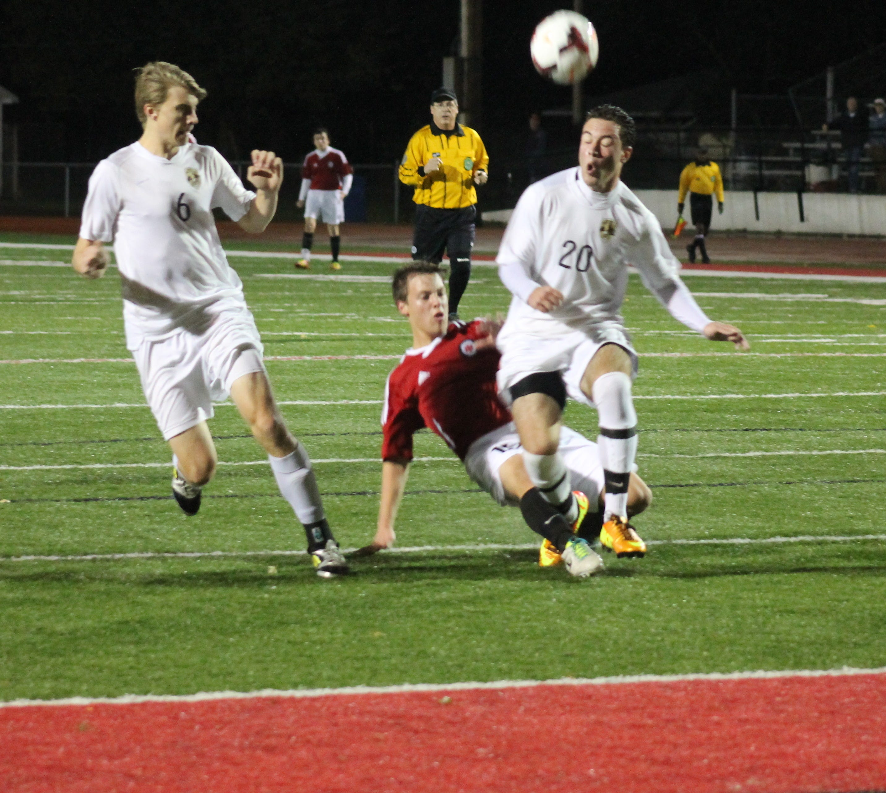 Indian Hill's Brooks Renfro is defended by Mitch Werner (20) and Zach Store (6) in the Division II state semifinal Nov. 6 at Huber Heights Wayne.
