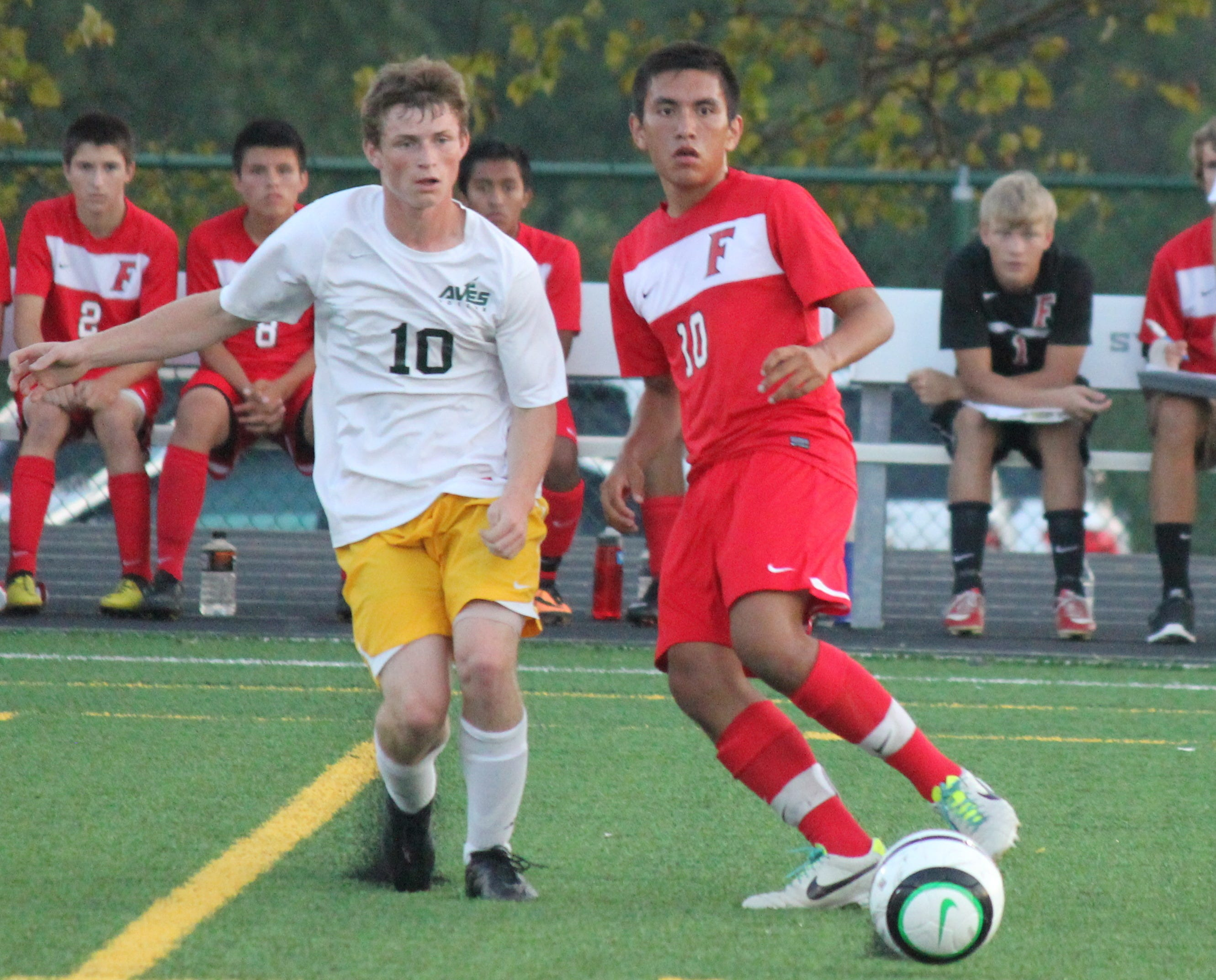 Sycamore forward Brennon Shanks and Fairfield's Yardley Gonzalez watch the flight of the ball as it goes toward teammates last September.