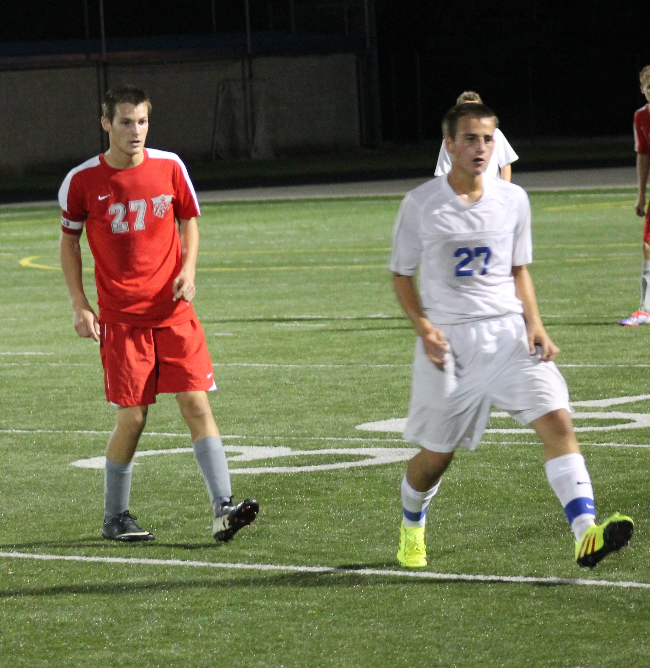 Bethel-Tate's Adam Shinkle, left, follows Zane Kuntz of Madeira Oct. 15 in the sectional tournament. The Mustangs held off the Tigers 3-2 in Bethel-Tate's season finale last fall.