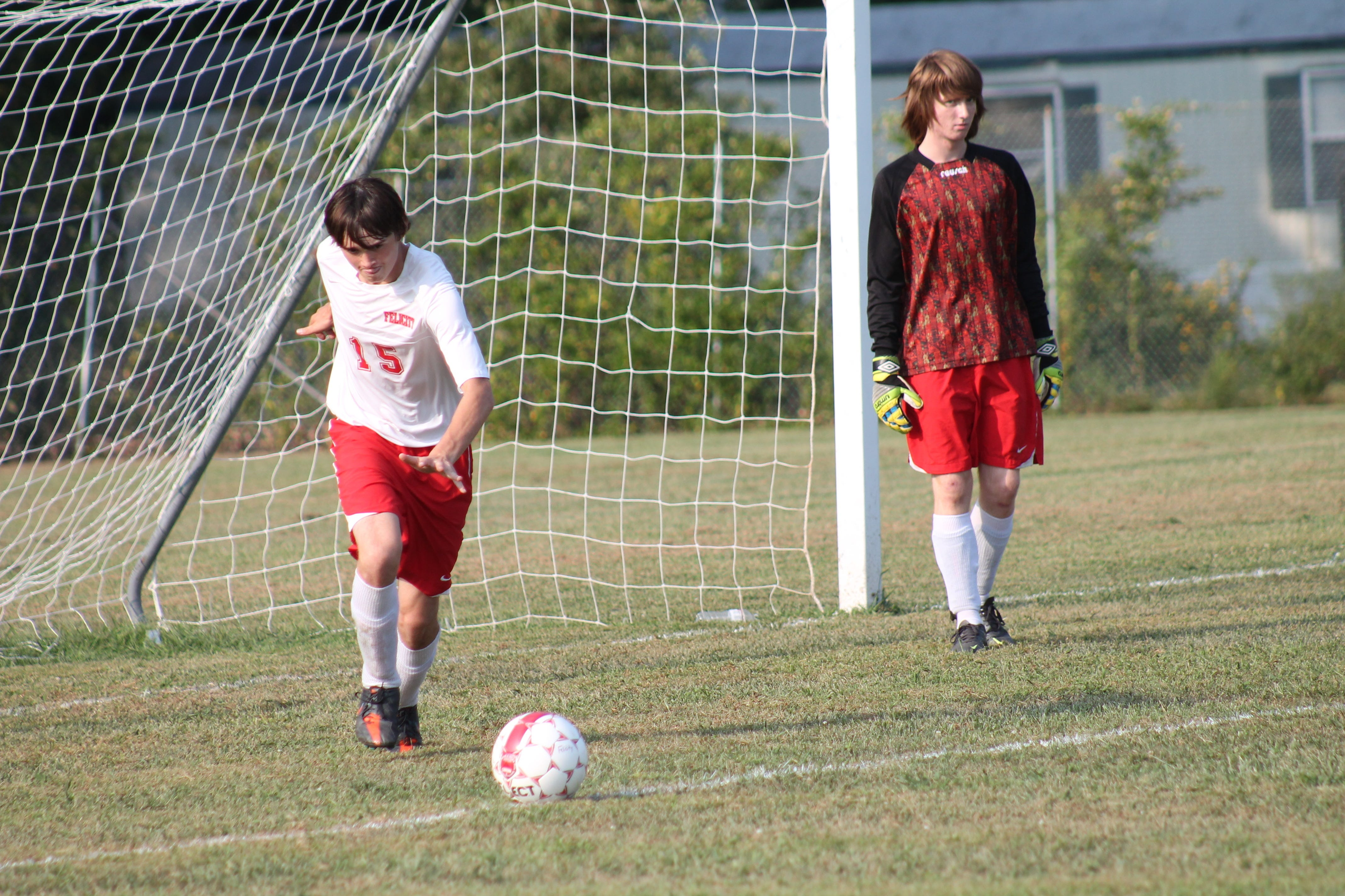 Kyle Lauderback takes the goal kick for Felicity-Franklin against Amelia last September as keeper Jared Tackett stands to the right.