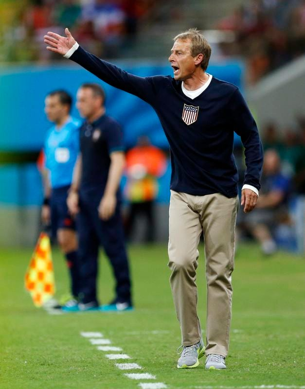 United States coach Juergen Klinsmann shouts instructions to his players during the team's game against Portugal on Sunday in Manaus, Brazil.