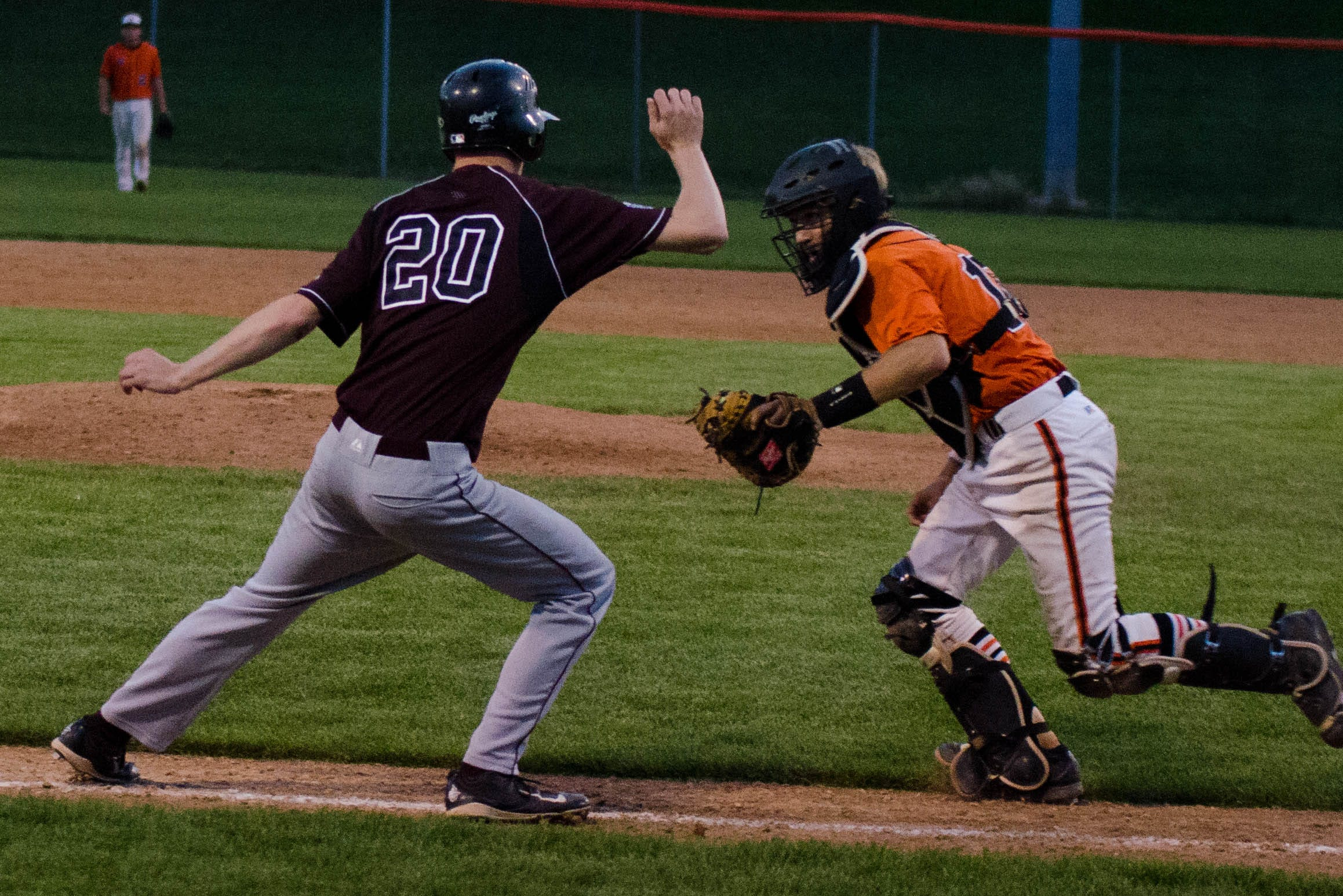 Dowling Catholic's Ben Olson, left, gets caught between third base and home by Valley catcher Mason Whitham during Tuesday's baseball doubleheader at Valley. The Maroons were victorious 9-3 in Game 2 after dropping the opener 4-3.