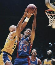 Dennis Rodman grabs a rebound away from Kareem Abdul-Jabbar during Game 3 of the 1989 NBA Finals in Los Angeles.