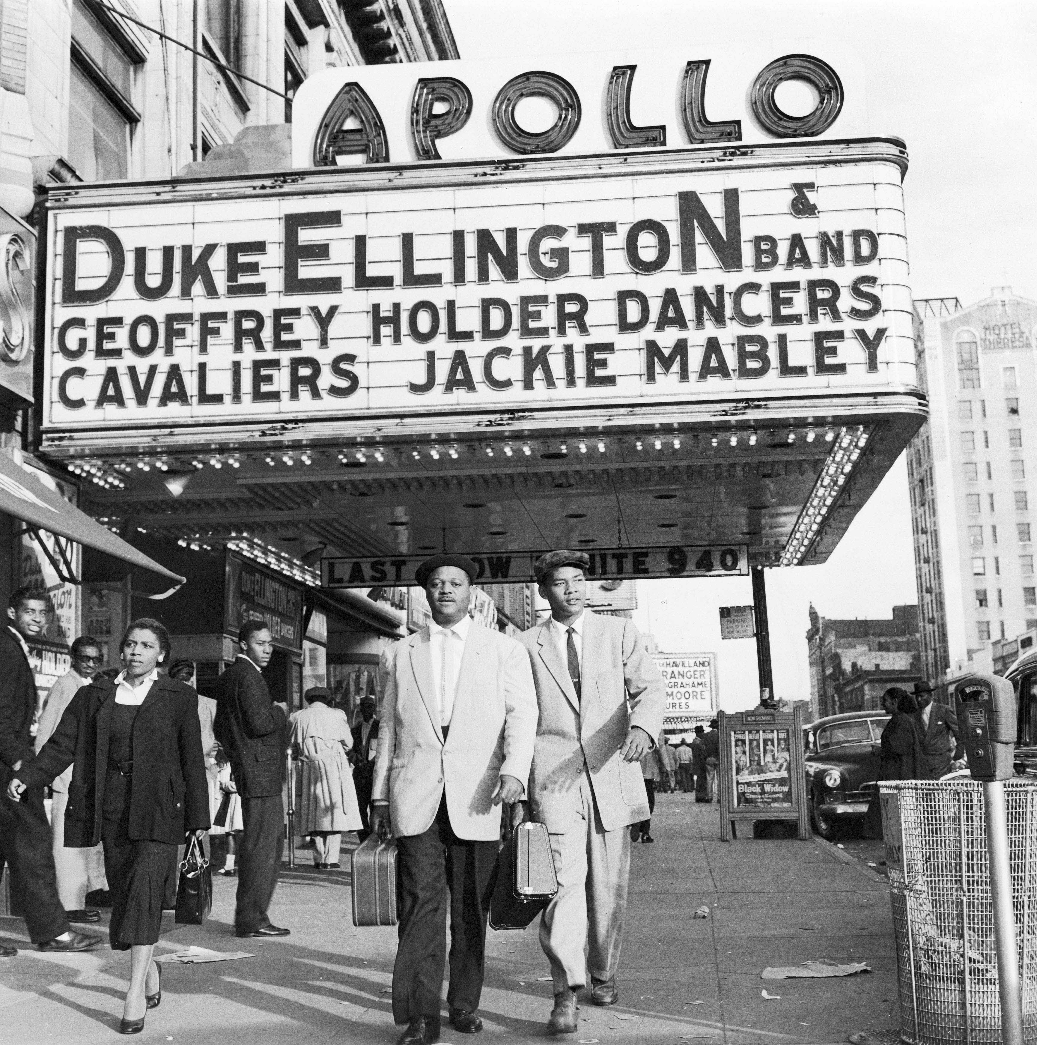 """In this 1955 file photo, trumpeter Clark Terry walks with his son Rudolph under the Apollo Theater marquee after Terry's first stage show with Duke Ellington's band in the Harlem neighborhood of New York City. The documentary """"Keep on Keepin' On,"""" which is being show at the Lyric Cinema Cafe in Fort Collins tells the tale of Terry's career as an influential trumpet player and studio musician."""