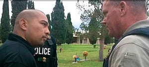 This photo provided by the Cottonwwood, Ariz., Police Department shows Cecilio Cruz, left, and Cottonwood, Ariz., police Sgt. Tod Moore at a funeral home and cemetery in Tucson. Police in the city of Cottonwood, about 100 miles north of Phoenix, said Cruz fatally shot 17-year-old Marisol Gonzalez in the face on March 25, 1997.