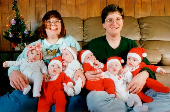 Becky and Keith Dilley celebrate the first Christmas with the sextuplets in 1995. Babies from the left: Claire, Quinn, Brenna, Adrian, Ian and Julian.