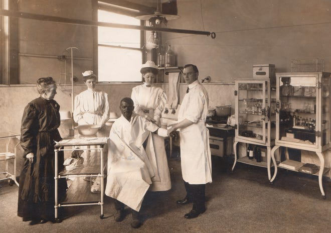 City Dispensary matron Gertrude Oakes, nurses Mary McCoy and Blanche Neff and Dr. M.N. Hadley attend to a patient in 1910.