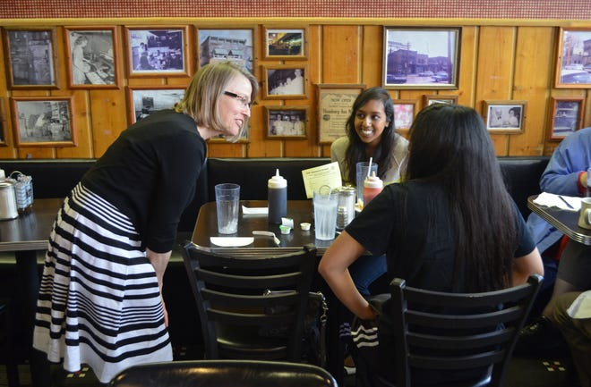 Republican congressional hopeful Mariannette Miller-Meeks speaks with Hamburg Inn No. 2 diners Tanzeh Khan, 22, (background) and Deborah Yu, 22, during a 2014 campaign stop in Iowa City.