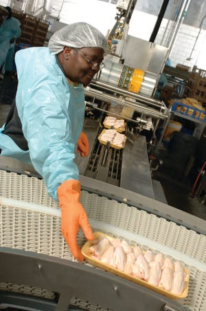 The Sanderson Farms plant in Summit slaughters, cuts and packages chicken for sale at restaurants and grocery stores.