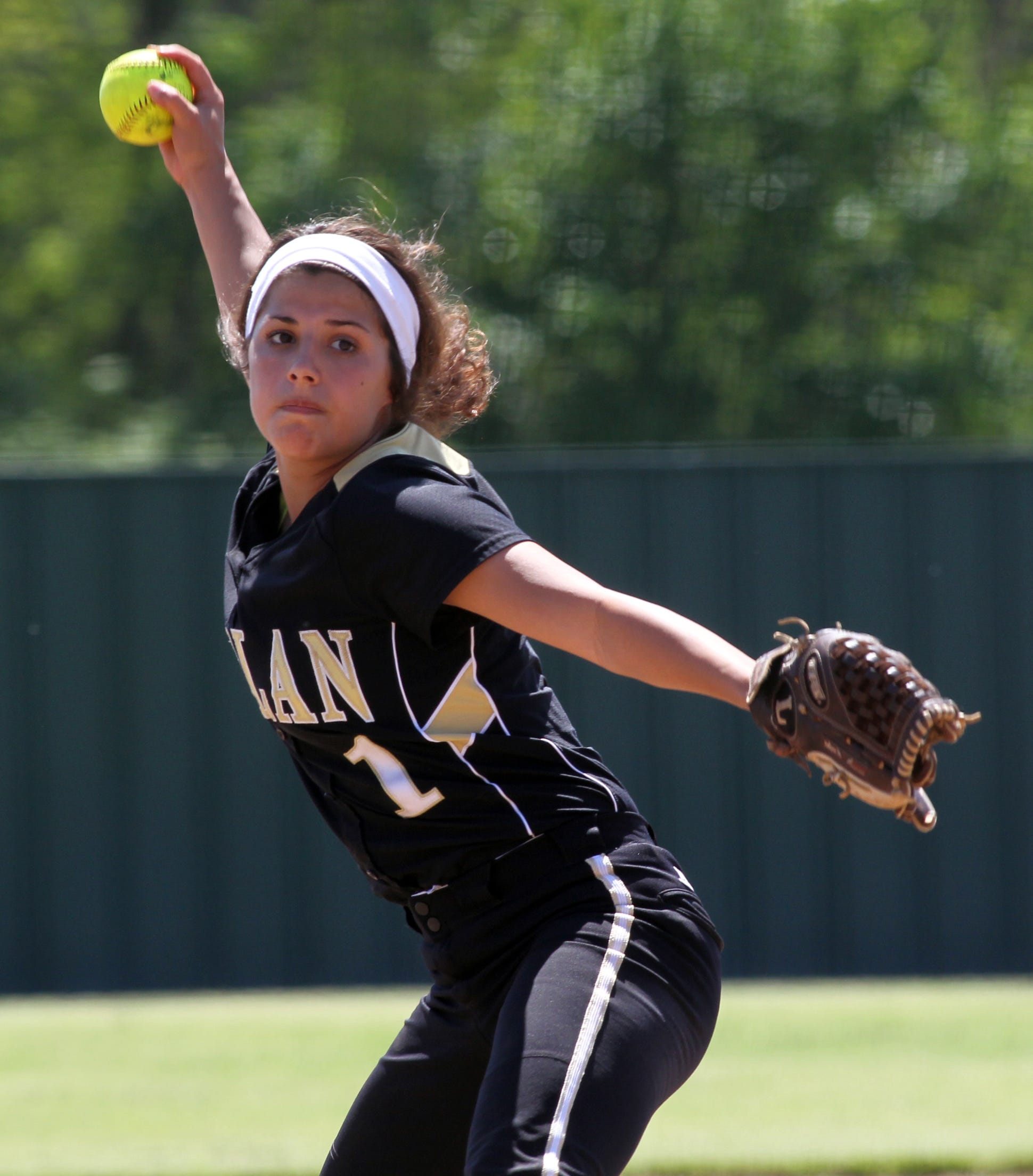 Kaplan rides the arm of pitcher Abby Trahan.