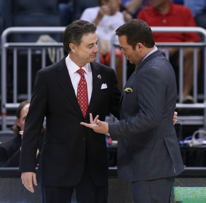 U of L coach Rick Pitino, left, and Manhattan's Steve Masiello — his former assistant — touch base before last Thursday's NCAA Tournament game in Orlando.