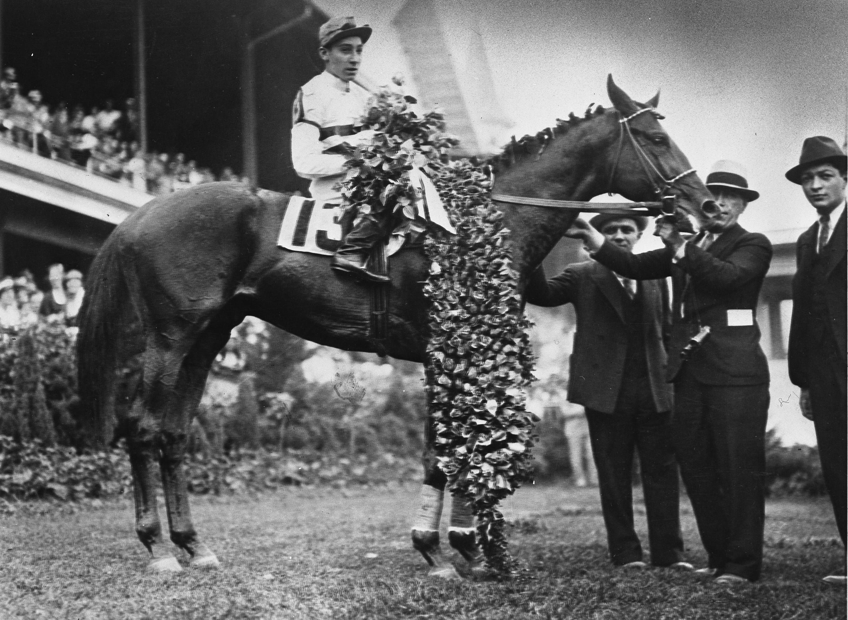 Burgoo King gets the roses in the 1932 Kentucky Derby. Photo by The Courier Journal May 7, 1932 Publication.
