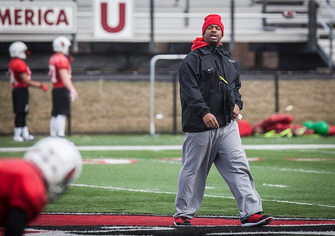 Ball State wide receivers coach Alex Bailey works with players during practice at Scheumann Stadium Tuesday.