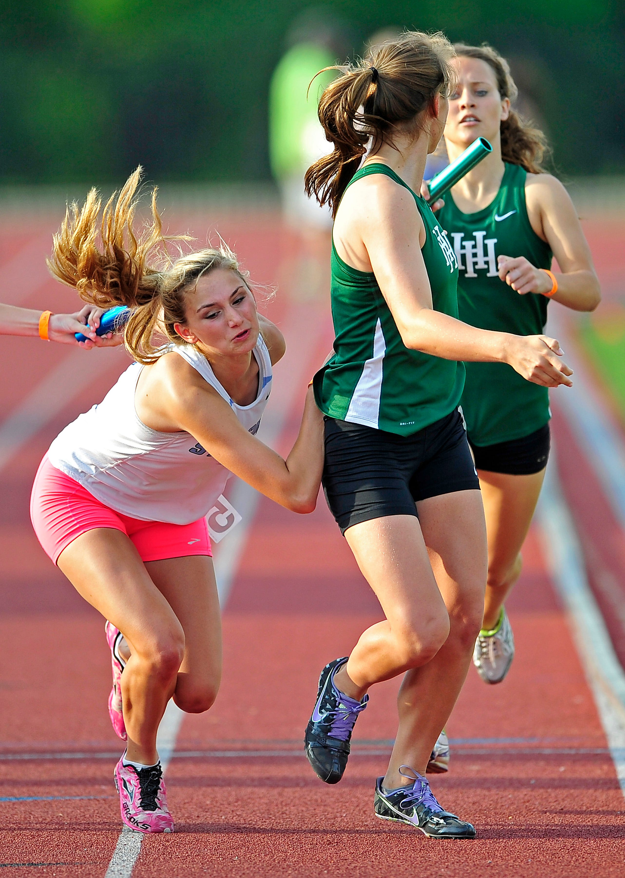 Harpeth Hall's Sophie Pilkinton, right, helped the 4x400 and 4x800 relay teams win state titles.