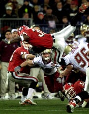 Georgia running back Verron Haynes leaps up and over the line for yardage against Boston College in the 2001 Music City Bowl.