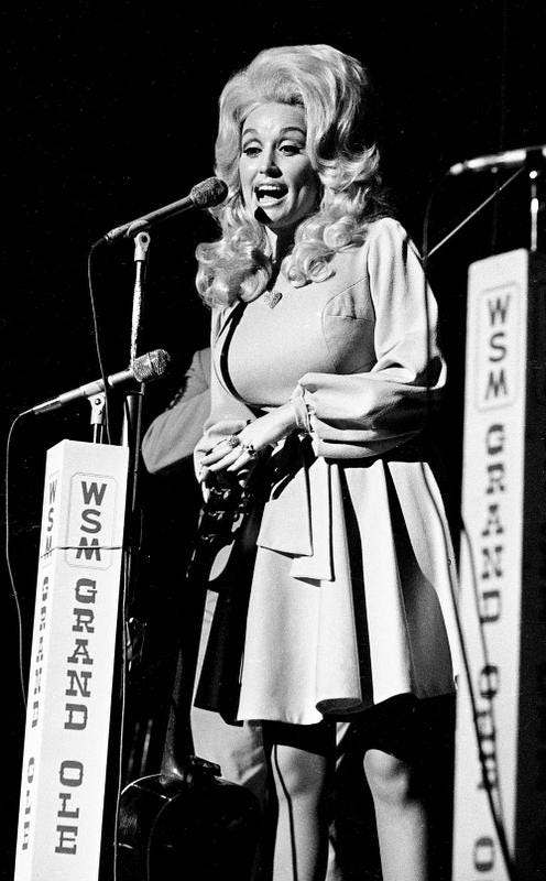 Dolly Parton is performing for a packed audience during the Grand Ole Opry show on the stage of the Ryman Auditorium July 21, 1973.