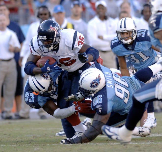 Texans' Ron Dayne is tackled by Titans Keith Bulluck and Robaire Smith during the second half at LP Field, Nashville, Tennessee, October 29, 2006. The Titans beat the Texans 28-22.