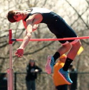 "Randolph's Anthony Zarro goes up and over 6' 2"" during the high jump at the Morris Hills Relays at Gifford Field, April 19, 2014, Rockaway, NJ."