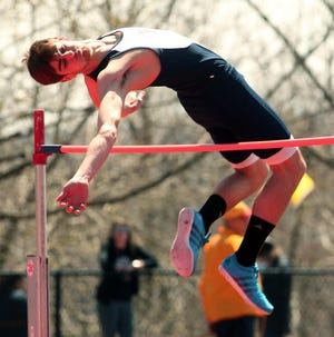 """Randolph's Anthony Zarro goes up and over 6' 2"""" during the high jump at the Morris Hills Relays at Gifford Field, April 19, 2014, Rockaway, NJ."""