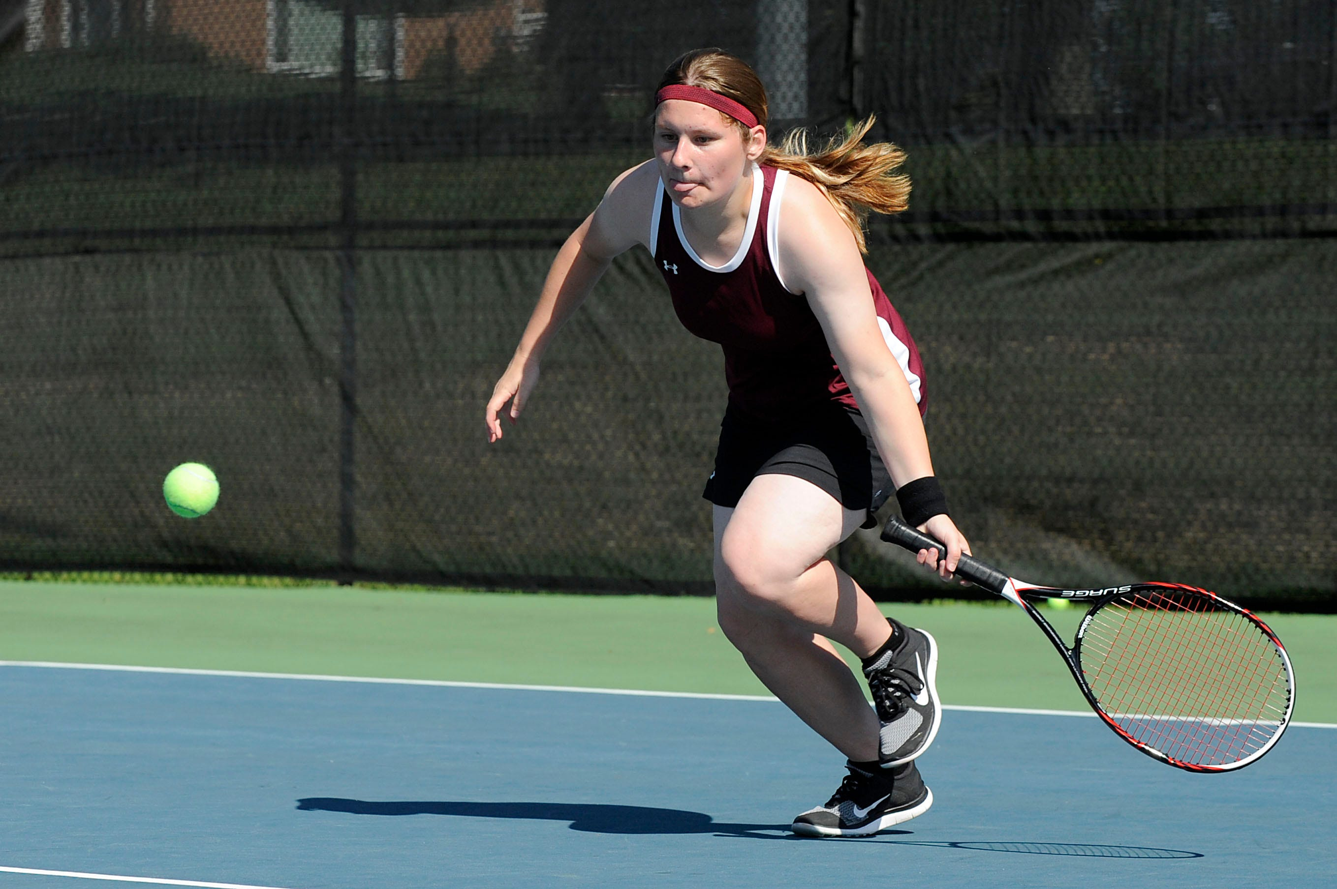 Newark's Nicole Gilliam returns the ball during a No. 1 doubles match against Watkins Memorial during Saturday's Licking County girls tennis tournament at Denison. Gilliam teamed with Katie Huang.