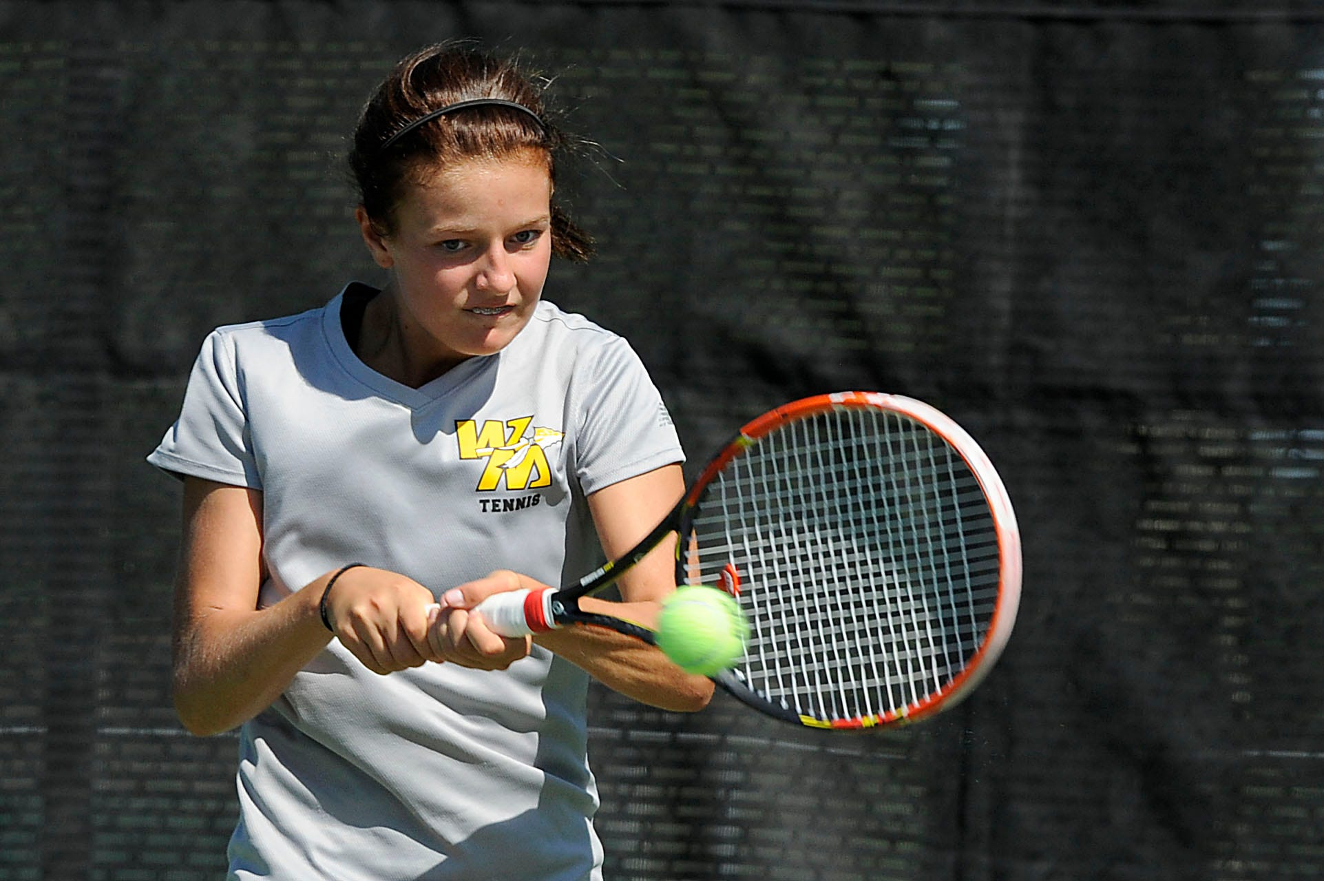 Watkins Memorial's Alexis Steer hits a ball to Granville's Charlotte Purnode in a No. 1 singles match during Saturday's Licking County tournament at Denison. Steer won both of her matches.