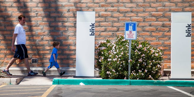 Blink Network electric vehicle charging stations, like this one in a Fry's parking lot off Ray Road and Ranch Circle, are to stay at their locations around the Valley despite low revenue and the bankruptcy of the network's installer, ECOtality Inc.