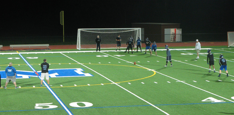 The Millbrook High School football team runs an onside kick drill early Monday morning in Millbrook.