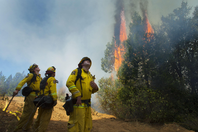 Cal Fire strike crews battle the King Fire in El Dorado County near Fresh Pond, Calif. on Sept. 17, 2014.