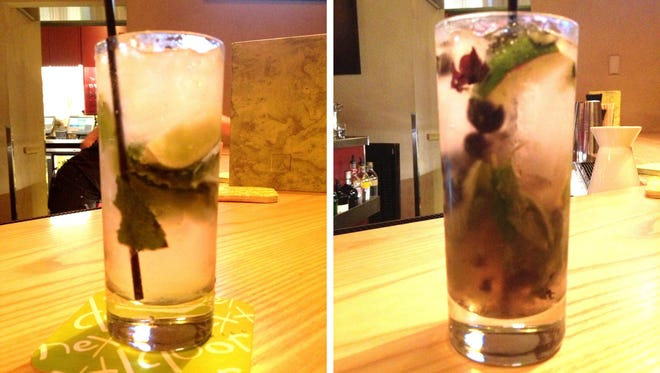 Mojitos at the Next Door Bar and Grill include traditional, left, and Brazilian blueberry, made of cachaca, blueberries, fresh mint and lime.