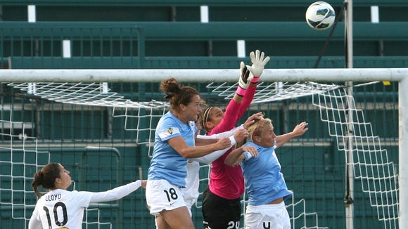 Flash's Carli Lloy watches as Chicago's Jackie Santacaterina jumps next to Flash goalie Adrianna Franch who reaches for the ball over Chicago's Alyssa Mautz,