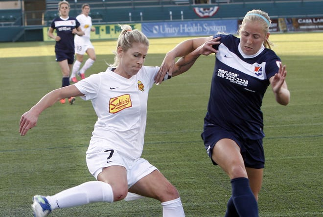 Flash's McCall Zerboni, left, cuts back against Sky Blue's Kendall Johnson during National Women's Soccer League action.