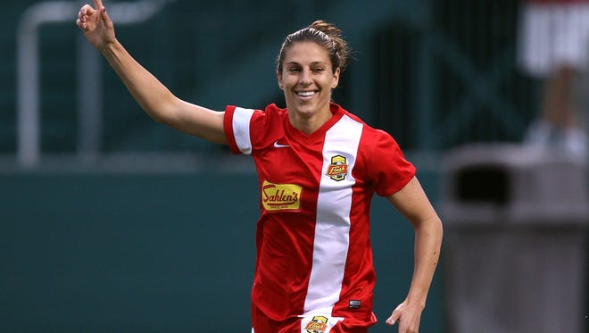 Carli Lloyd of the WNY Flash celebrates one of her goals in the first half against the Washington Spirit.