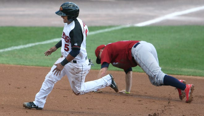 Eduardo Escobar passes by third base on his way to home plate as Lehigh's Cody Asche misses a tag in the second inning.