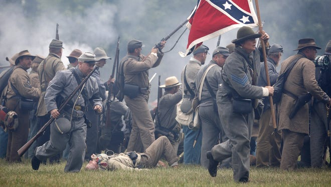 Confederate soldiers fight during a Civil War battle re-enactment at the Genesee Country Village and Museum.