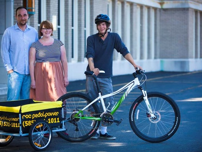 Scott Davignon  and Jessica Stadt, both owners of the new enterprise Power Pedal, which is  a new bicycle delivery service will haul your groceries. Kyle Roberts, 22, of Greece is the manager of the enterprise and the one who makes the deliveries throughout Rochester. The business believes in the importance of people power instead of gas power.