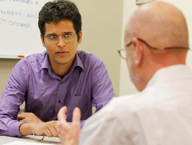 Intern Gagandeep Khangura, a second year post-grad student at the University of Rochester's Simon School, left, meets with Bob Kot, managing director, at High Tech Rochester Monday, June 17, 2013 in Henrietta.