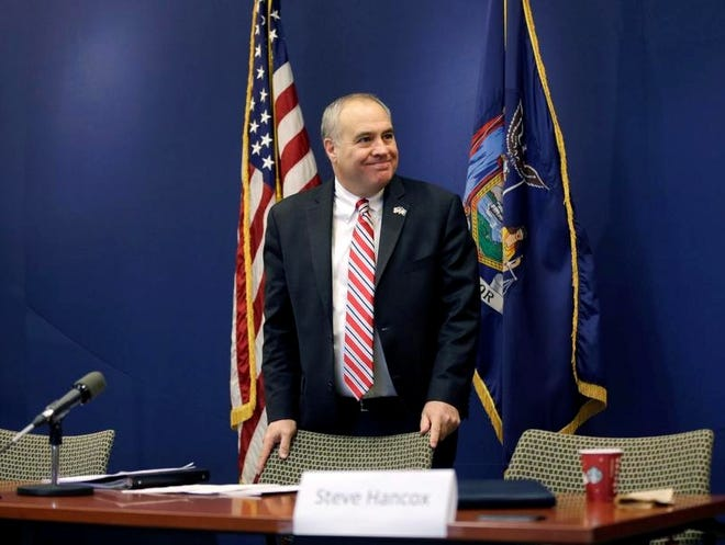 New York State Comptroller Thomas DiNapoli waits for a news conference to begin in this January file photo.