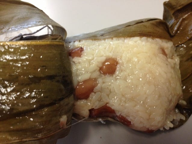 To eat zonzi, you take off the bamboo leaves, just as you would peel a tamale. The Shanghainese style of zongzi features marinated sticky rice and long slivers of pork, while folks from northern regions often make sweet zongzi with sweet red bean paste.