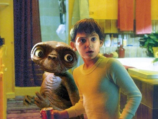 Elliott, played by Henry Thomas, shows E.T. around the house.