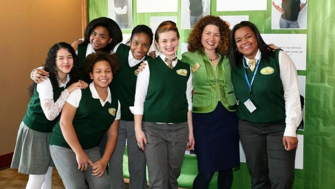 Laura Rebell Gross, second from right, is  right at home with the students at the Young Women's College Prep Charter School in Rochester.       Photo provided