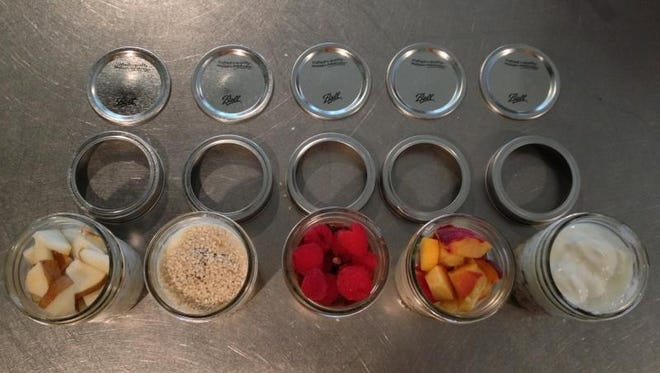 Jars are filled with muesli and a variety of other ingredients.