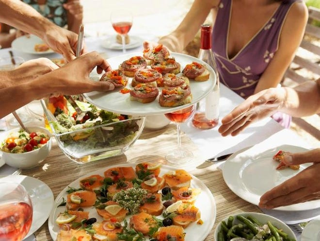 Instead of hosting a sit-down dinner, have friends over for hors d'oeuvres and drinks.